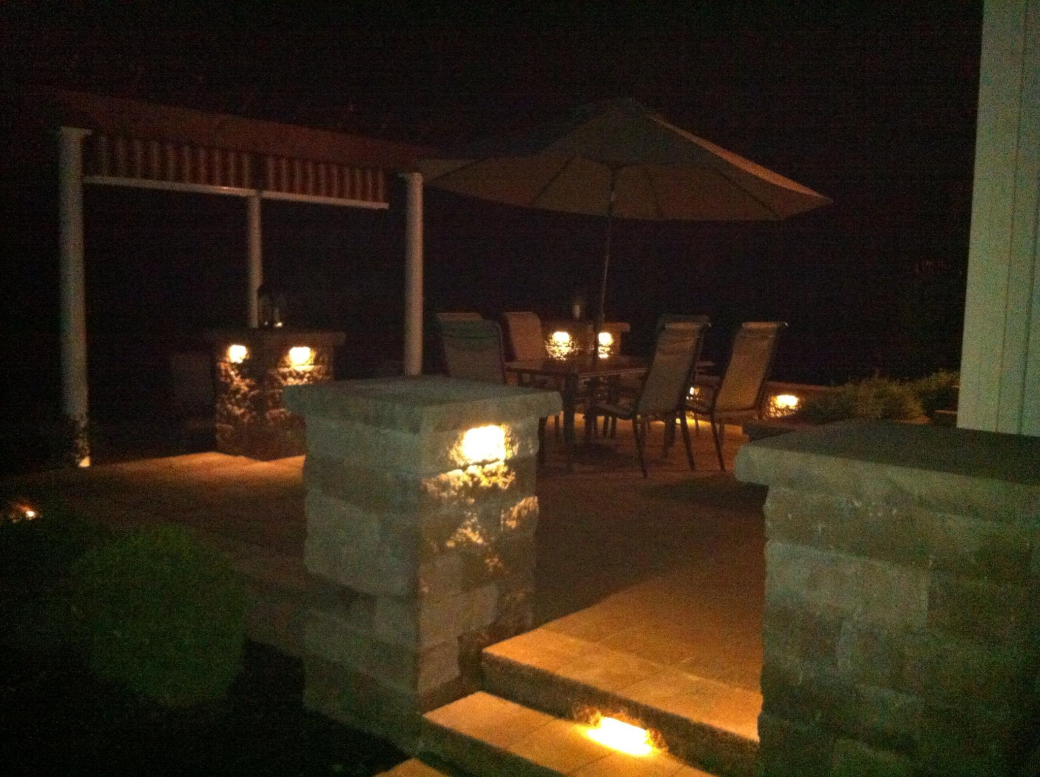 backyard patio with lighting and pergola greenmark landscapes